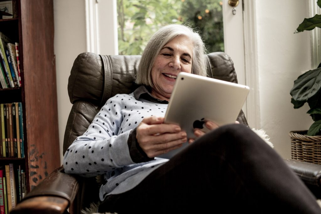 Woman reading on ipad